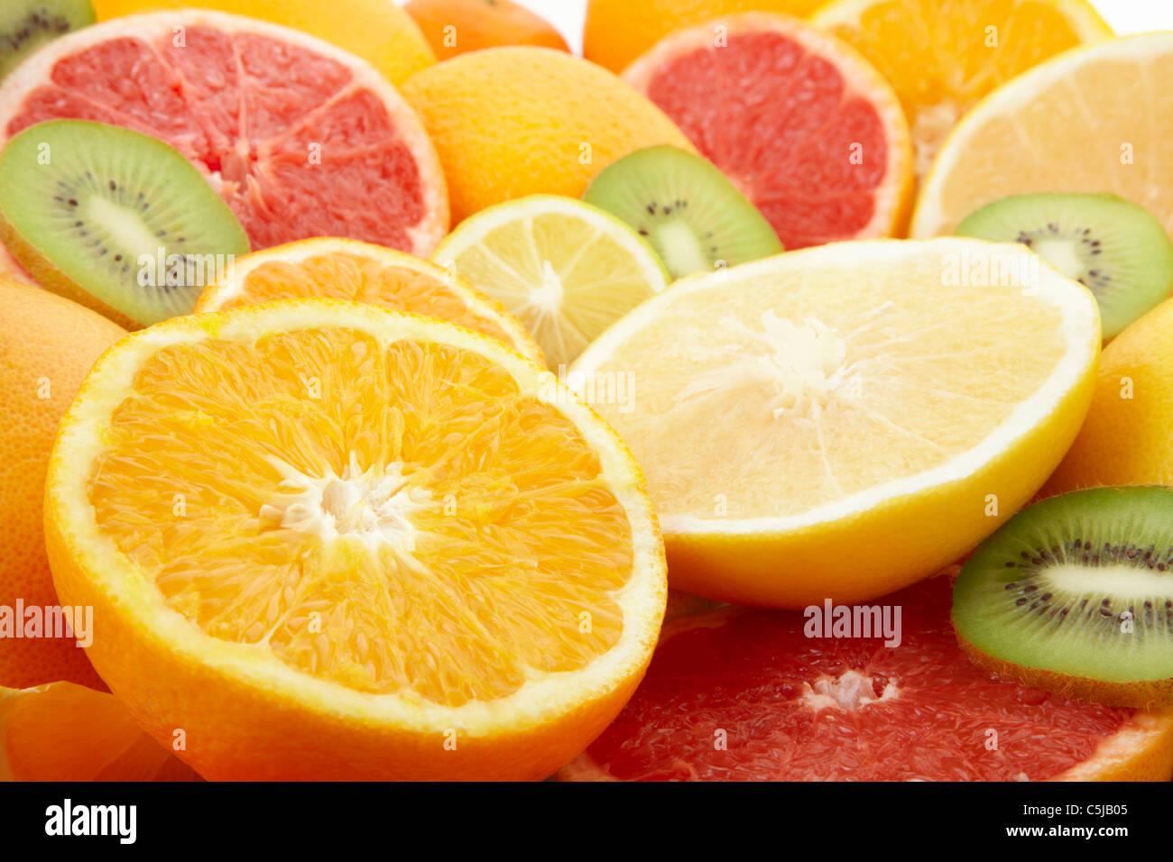 Fresh citrus fruits and kiwi background - Stock Image