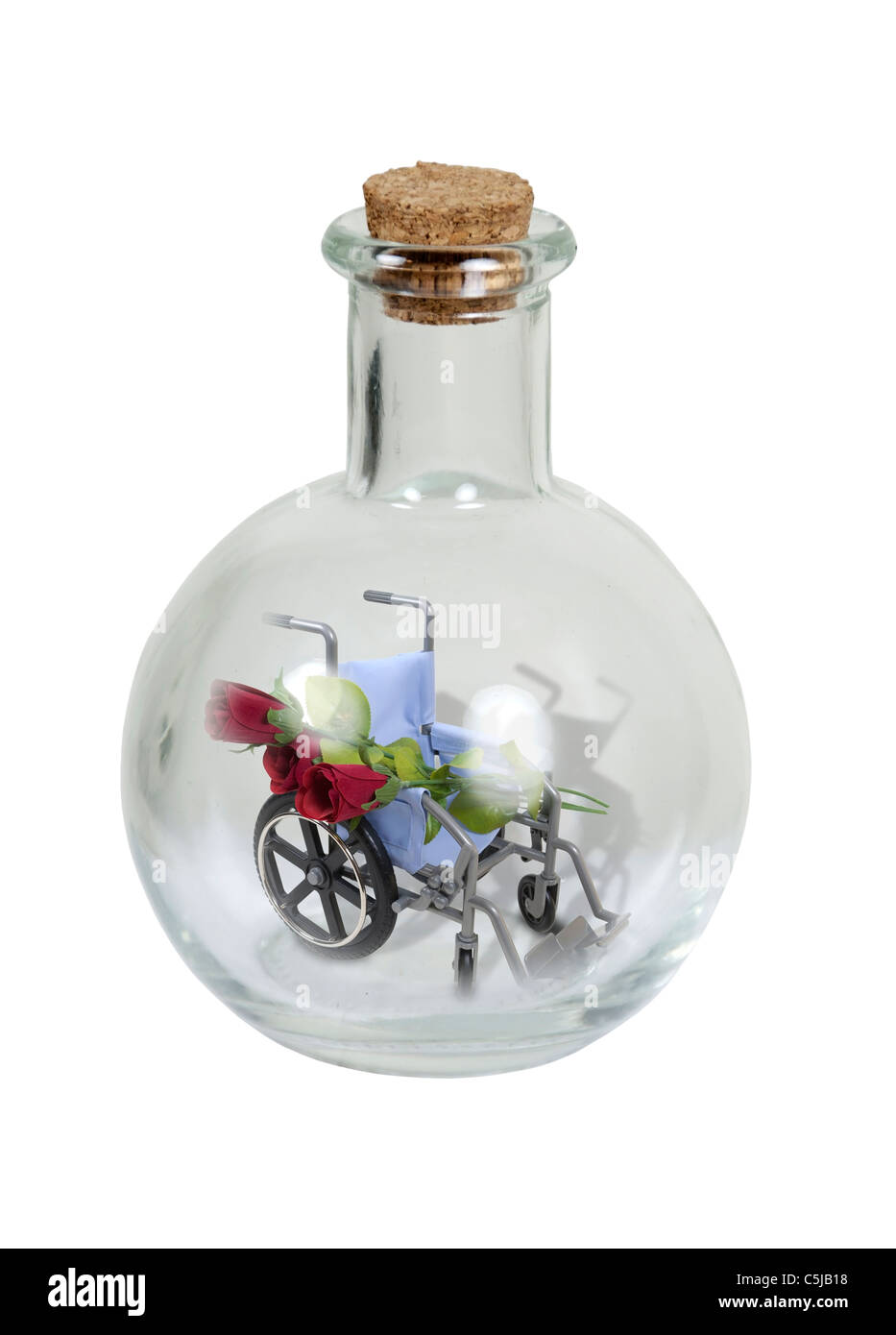 Elixir of health shown by a wheelchair with roses in a round glass bottle with cork stopper- path included - Stock Image