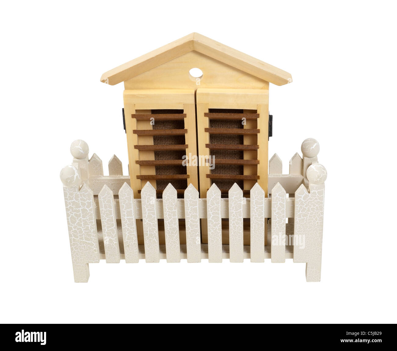 House with wooden shutters and a white picket fence - path included - Stock Image