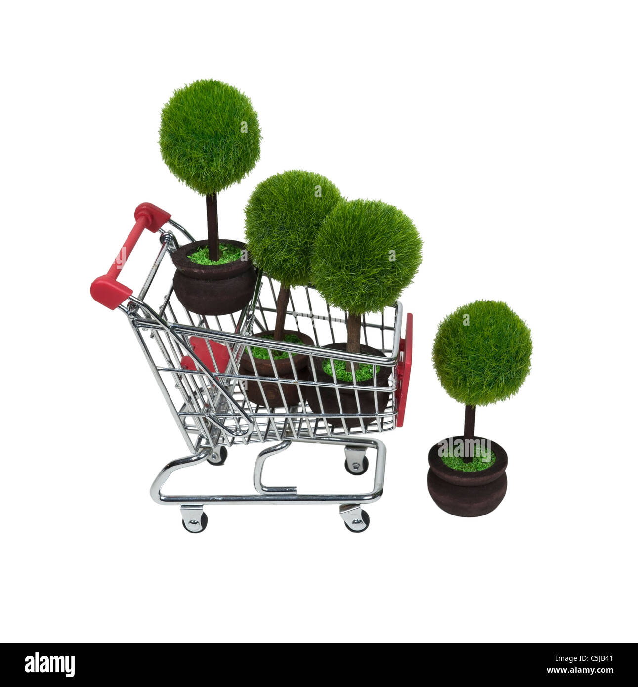 Shopping for renewable resources shown by several green potted trees in a shopping cart - path included - Stock Image