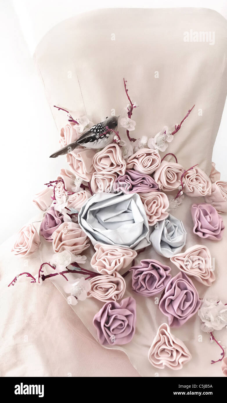 Close up of couture dress on mannequin. - Stock Image