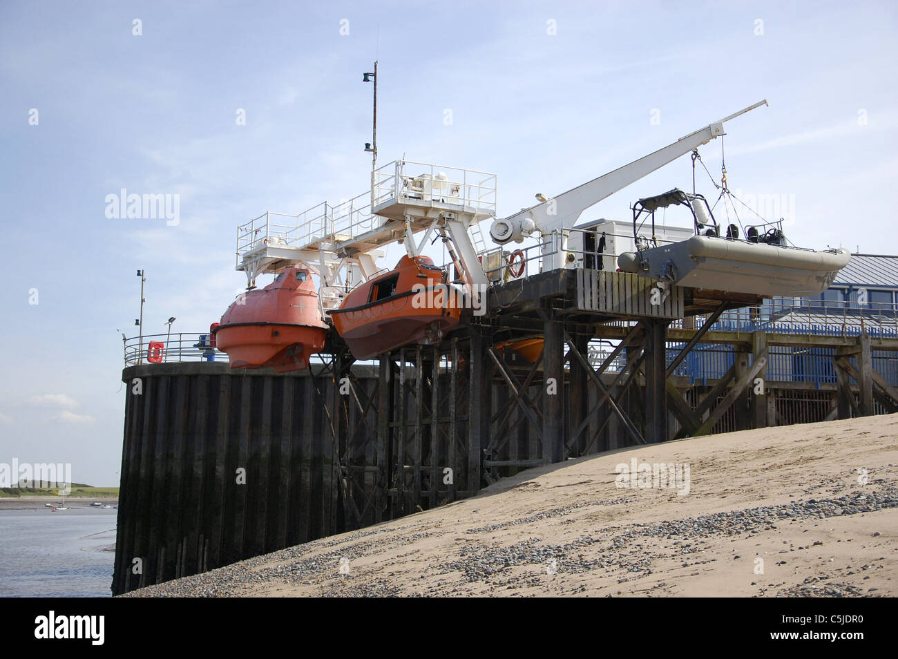 The boat launching station at Fleetwood with boats secured on davits and cables Stock Photo