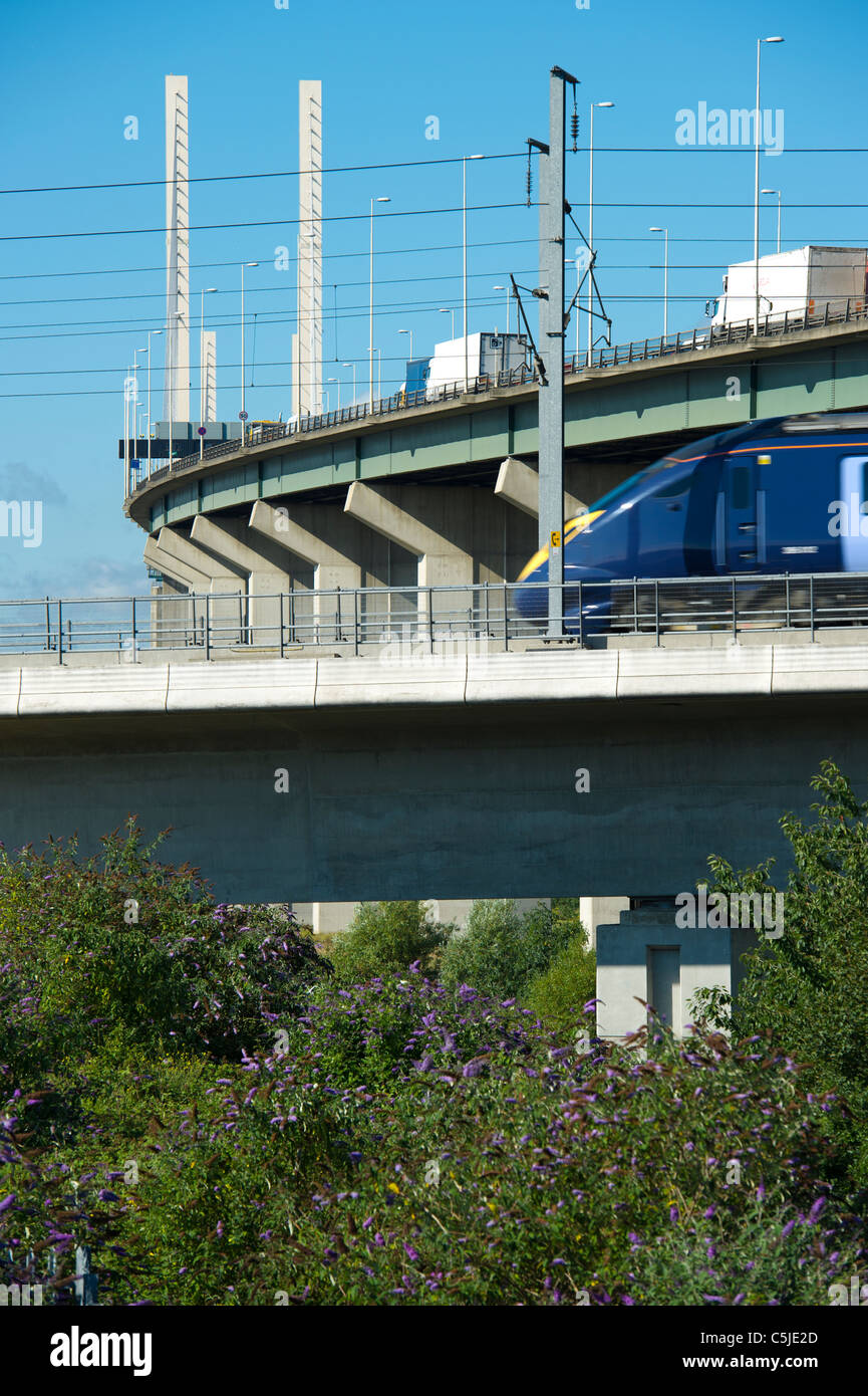 A train on the high speed rail link passes by the Dartford River Crossing in Thurrock,Essex, UK. - Stock Image