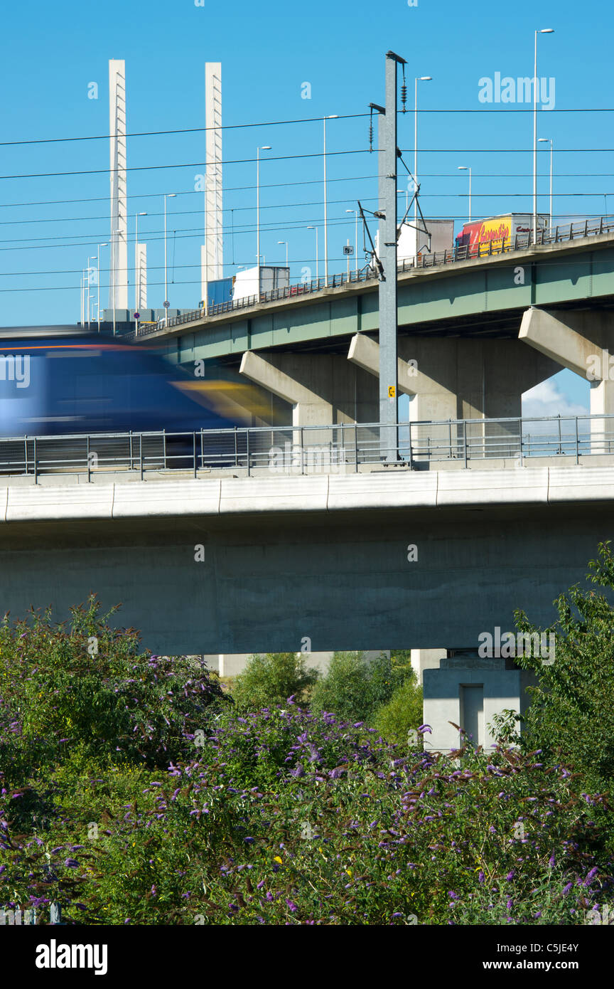 A train on the high speed rail link passes by the Dartford River Crossing in Thurrock,Essex, UK. Stock Photo