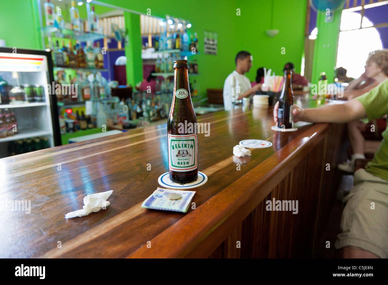 Bottle of Belikin beer on bar in Belize City, Belize - Stock Image