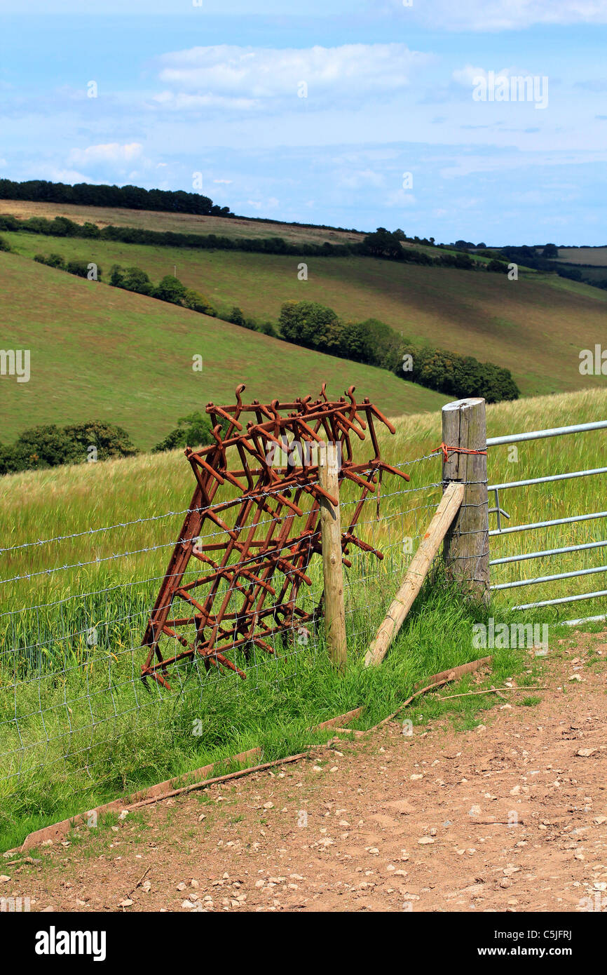 Harrow,Gate,fields Devon cove,Fence post and cloud,misc, fence, farming, keep, out, private,get of my land,farming - Stock Image