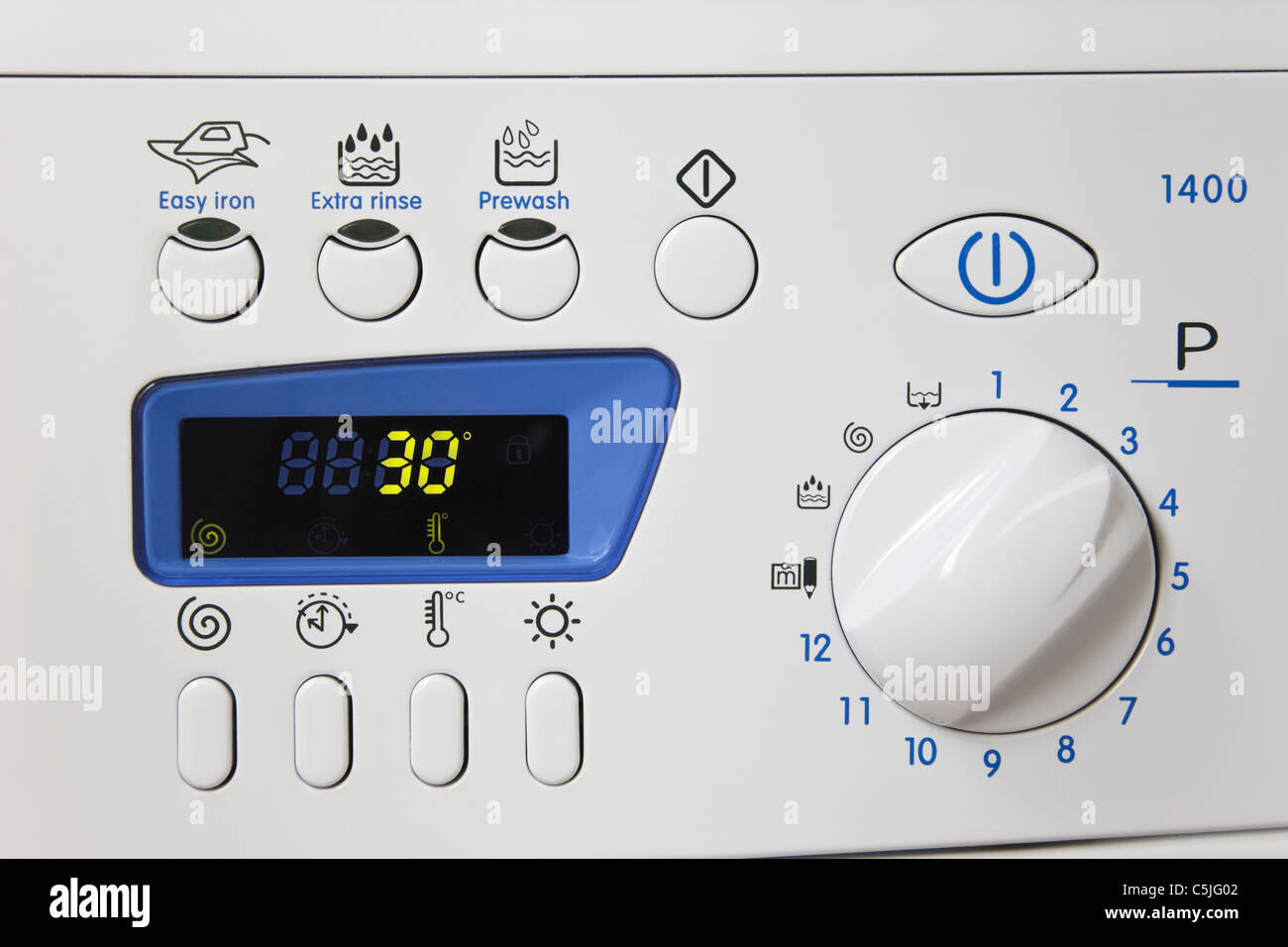 Automatic washing machine control panel set on an easy care program at a low temperature cool wash of 30 degrees - Stock Image