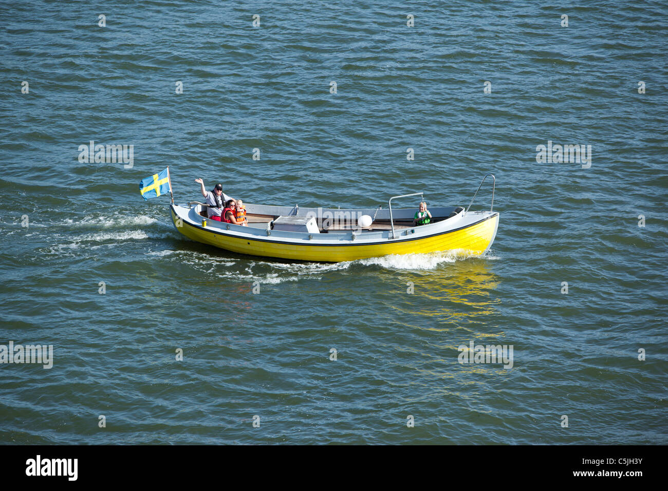 Family out there with his boat Stock Photo