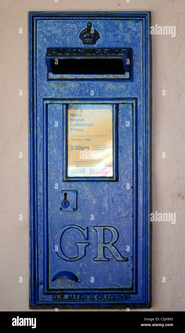 A blue letter box with GR for King George on Herm, Channel Islands, UK. - Stock Image