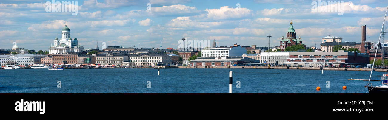 Helsinki skyline seen from the harbor with the Dome church, the Market Square and the Russian orthodox church Uzpenski - Stock Image