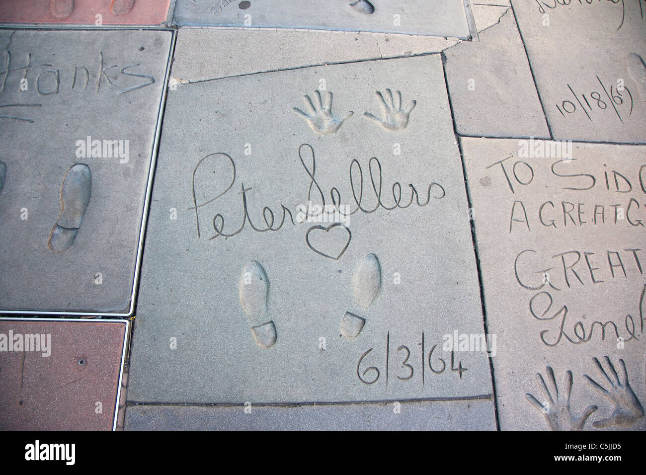 Peter Seller's hand and foot prints at Grauman's Chinese Theatre, Hollywood, Los Angeles, California, USA - Stock Image