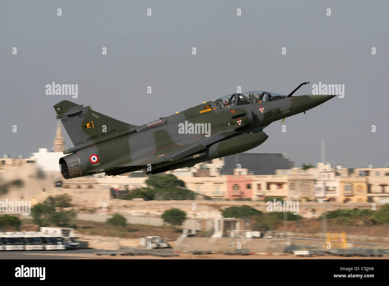 Military aviation. French Air Force Mirage 2000D combat jet taking off from Malta after an emergency landing during - Stock Image