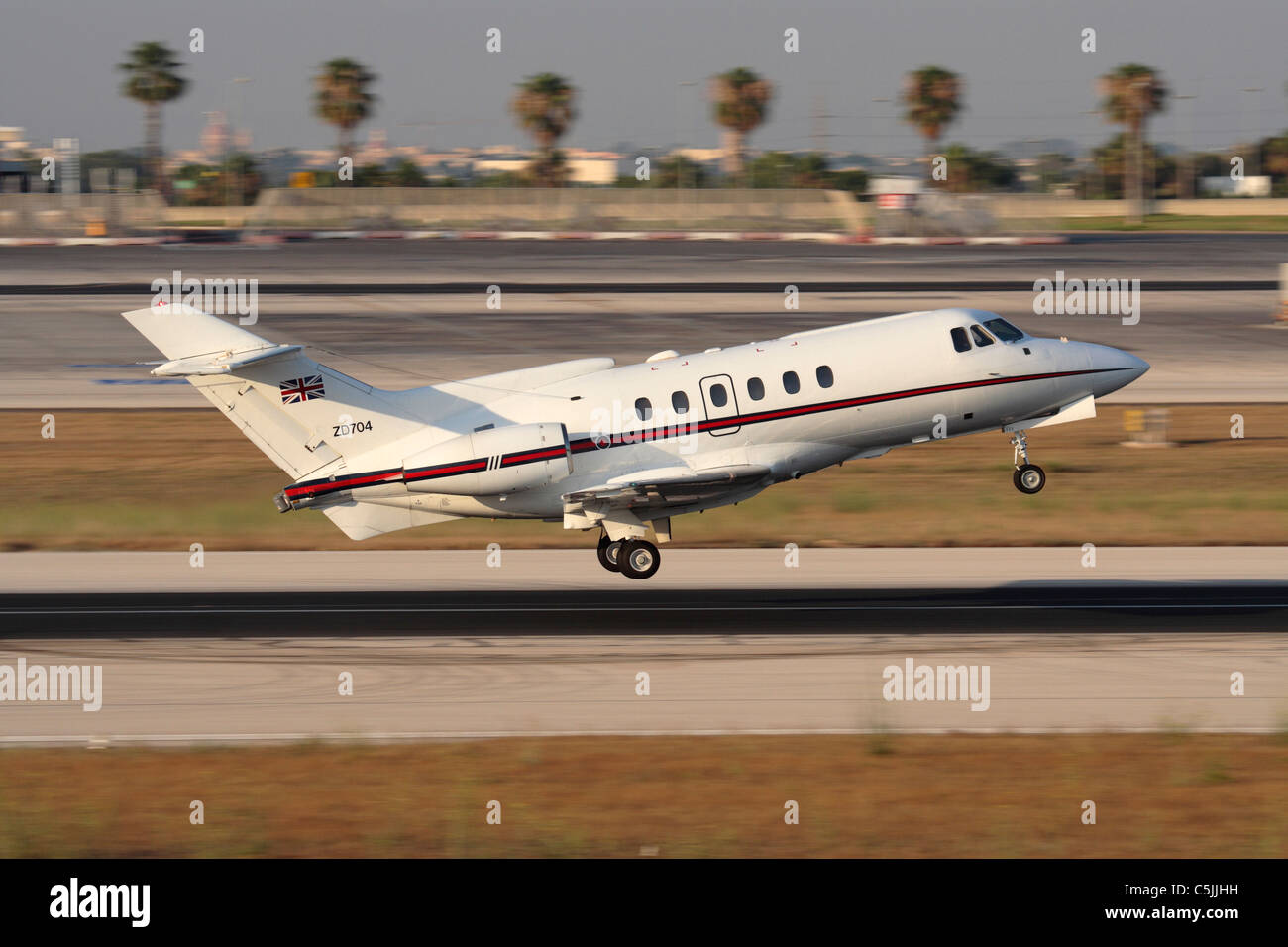 British Aerospace 125 corporate jet and VIP transport of the Royal Air Force taking off from Malta. Side view with - Stock Image