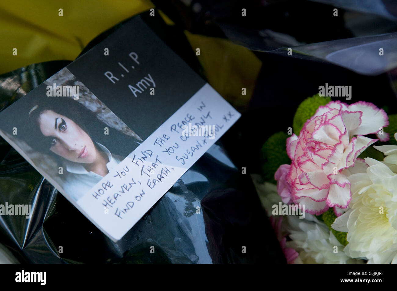 Flowers And Messages At The Memorial To Dead Singer Amy Winehouse