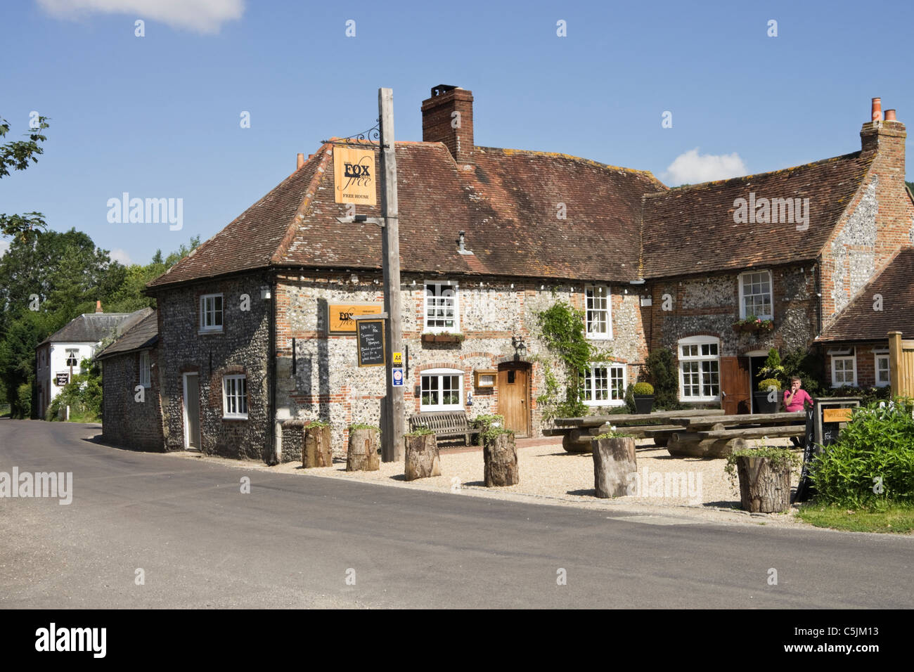 Traditional flintstone country village pub in South Downs National Park. Charlton, West Sussex, England, UK. - Stock Image