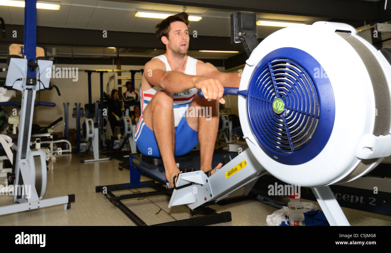 Tom James MBE Olympic Champion 2008, on rowing machine in the Redgrave Pinsent Rowing Lake and Sherriff Boathouse - Stock Image