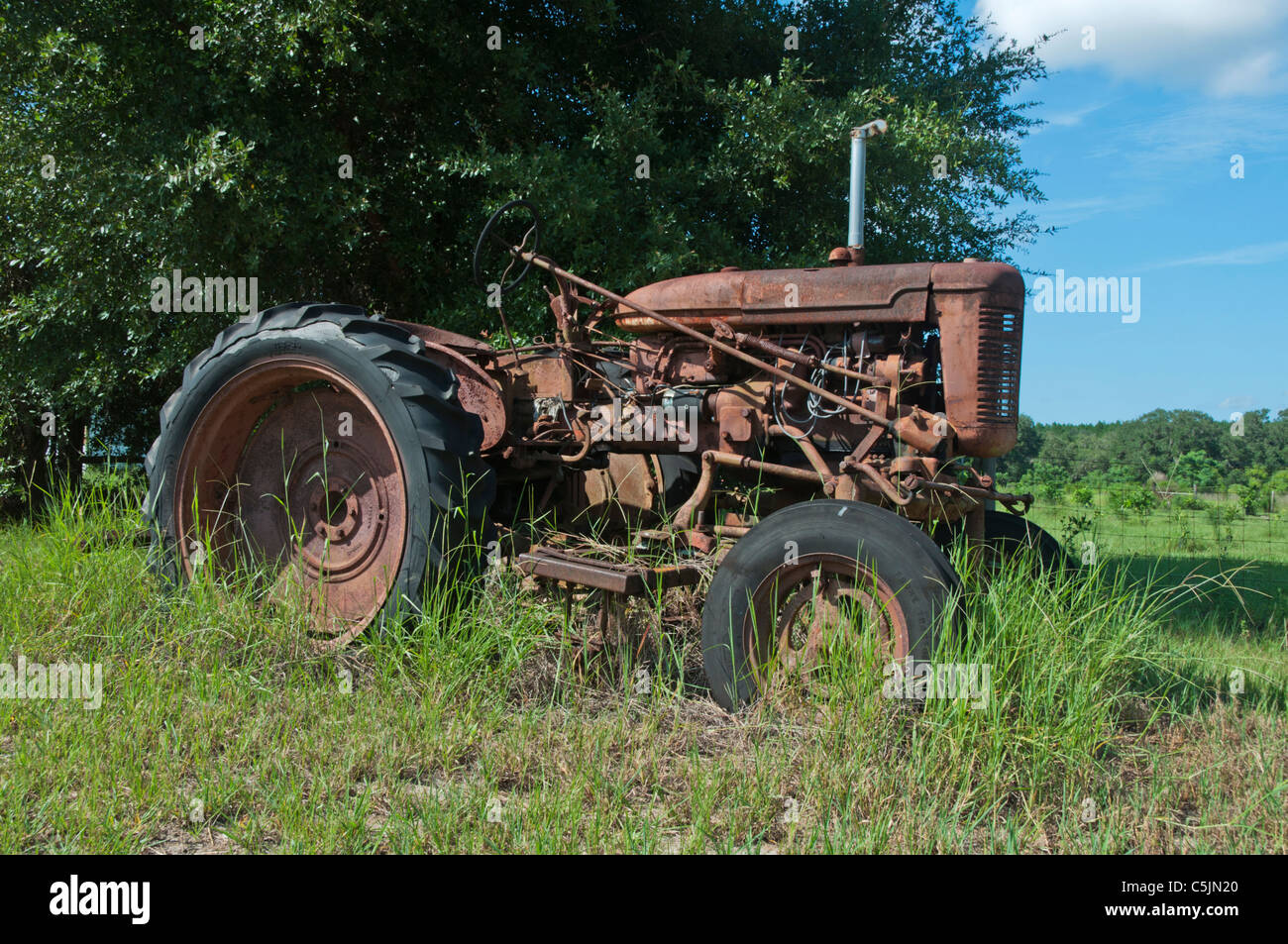 Antique International Farm Tractor from Yesteryear located in Leesburg, Florida USA - Stock Image