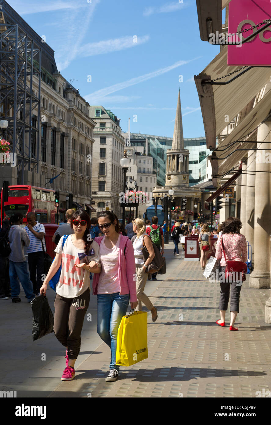 Young cool and trendy girls shopping in Regent street on a Sunday afternoon in Summer, London, England, Great Britain, - Stock Image