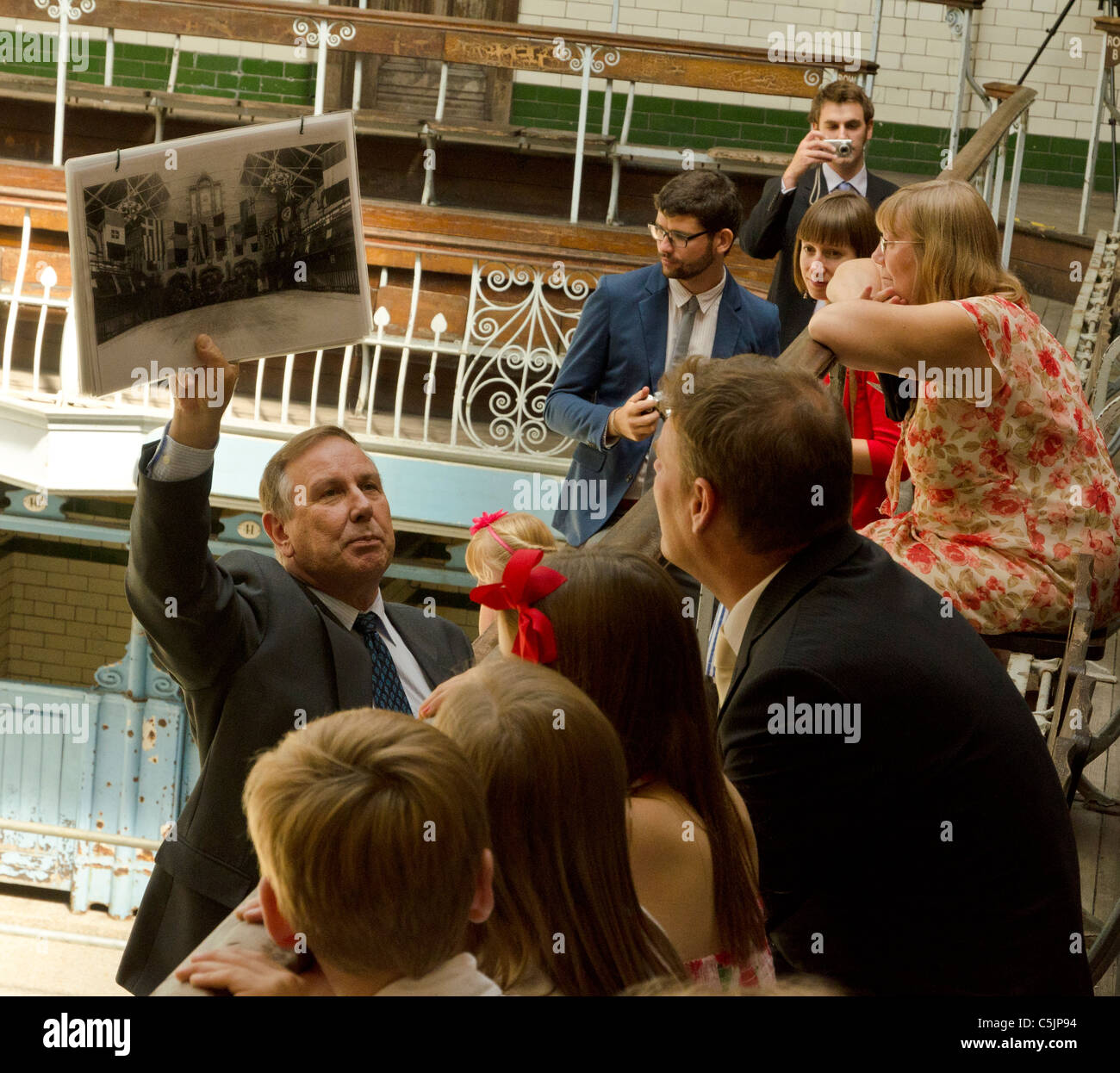 Guide tour illustrating the old Victoria baths pictures to visitors, Victoria Baths, Manchester, England, Great - Stock Image
