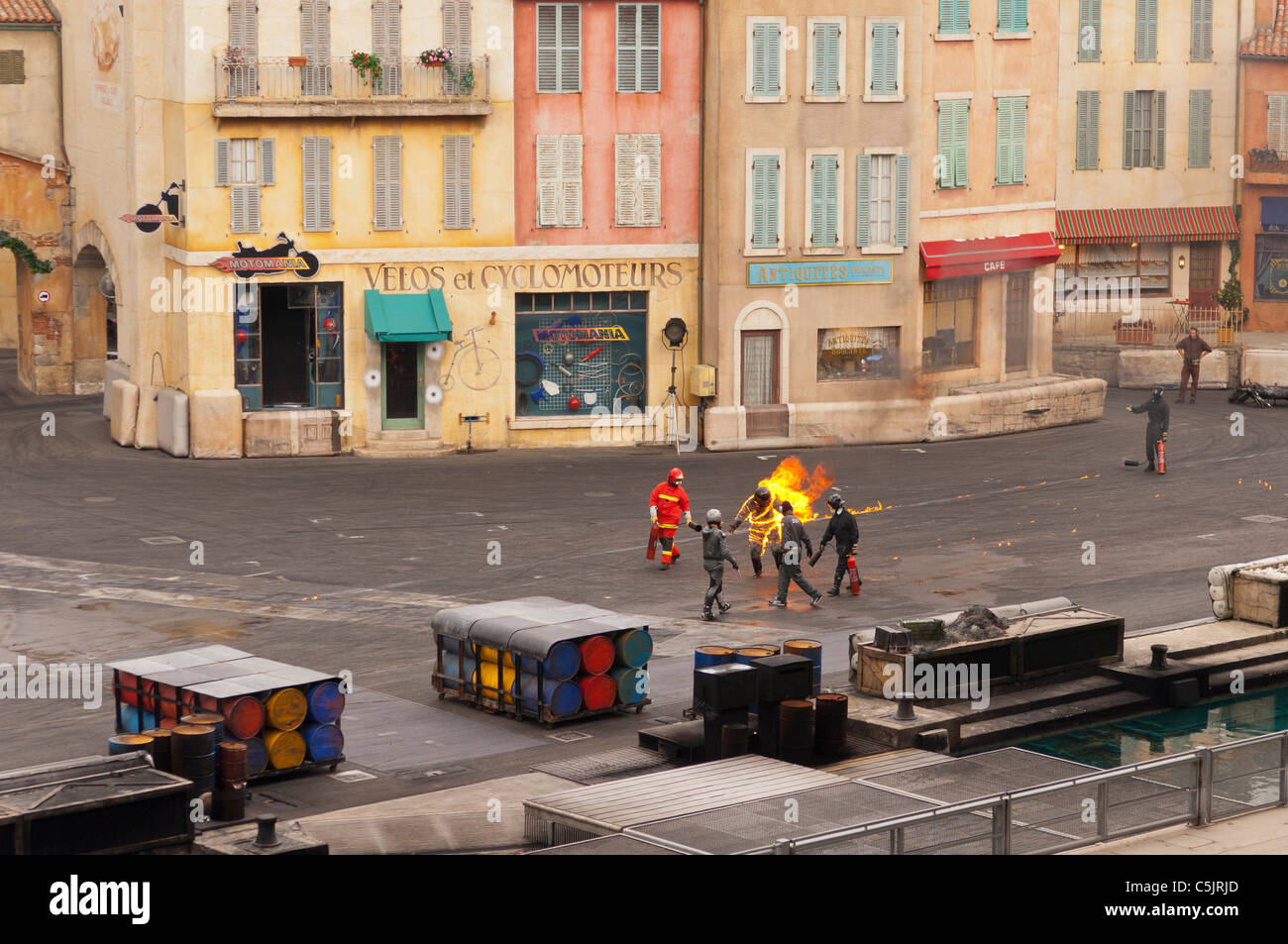 A stuntman on fire showing movement at the Moteurs...Action stunt show spectacular at Disneyland Paris in France Stock Photo