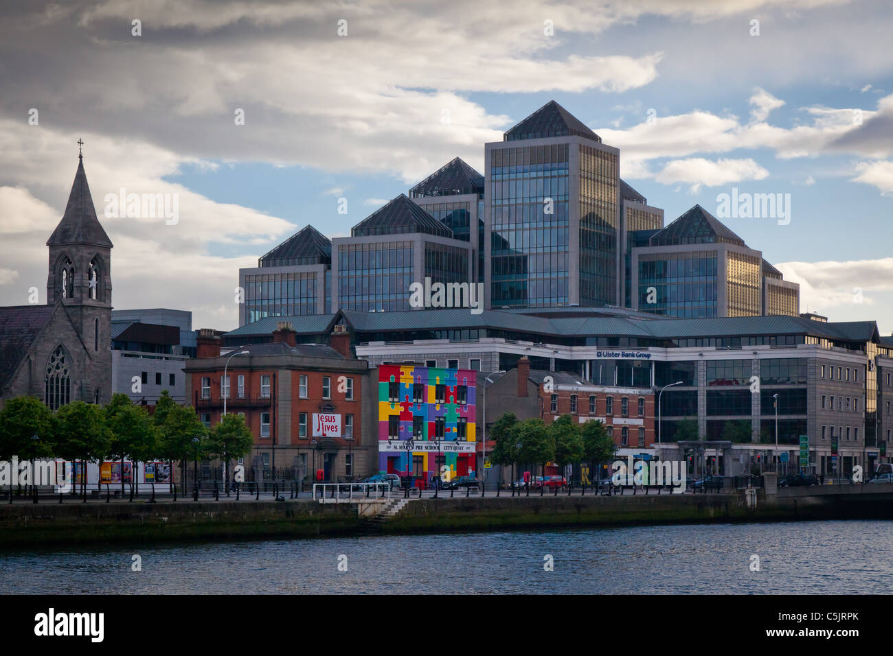 Downtown buildings and the river Liffey in Dublin, Ireland - Stock Image