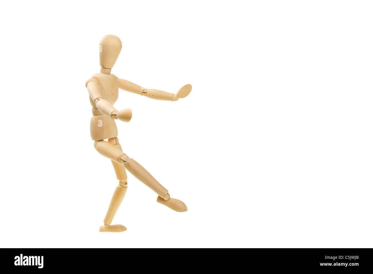Artist's wooden mannequin in a dancing pose - Stock Image