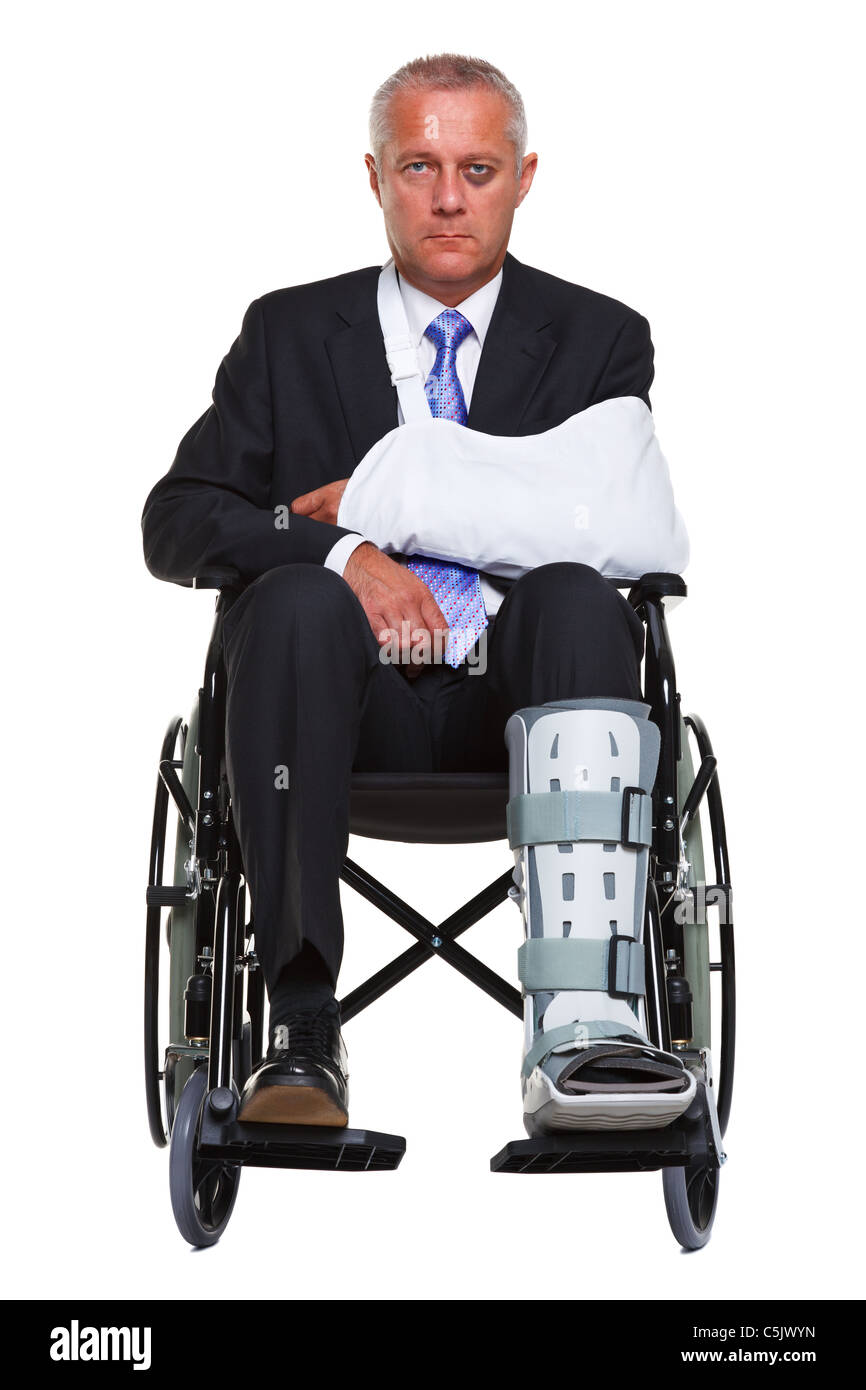 Photo of an injured businessman sitting in a wheelchair, isolated against a white background. - Stock Image