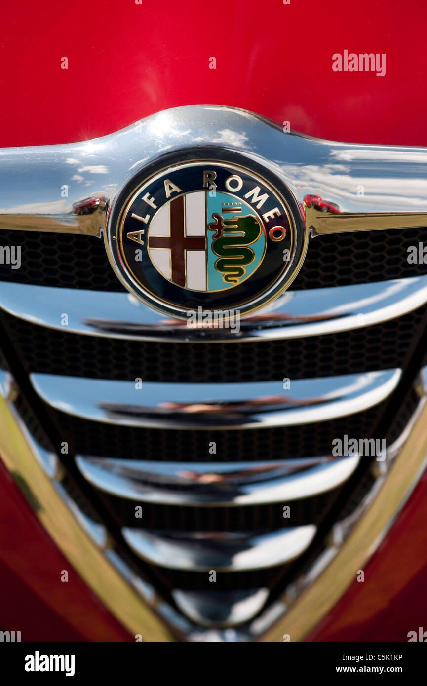 Alfa Romeo car badge and radiator grille detail - Stock Image