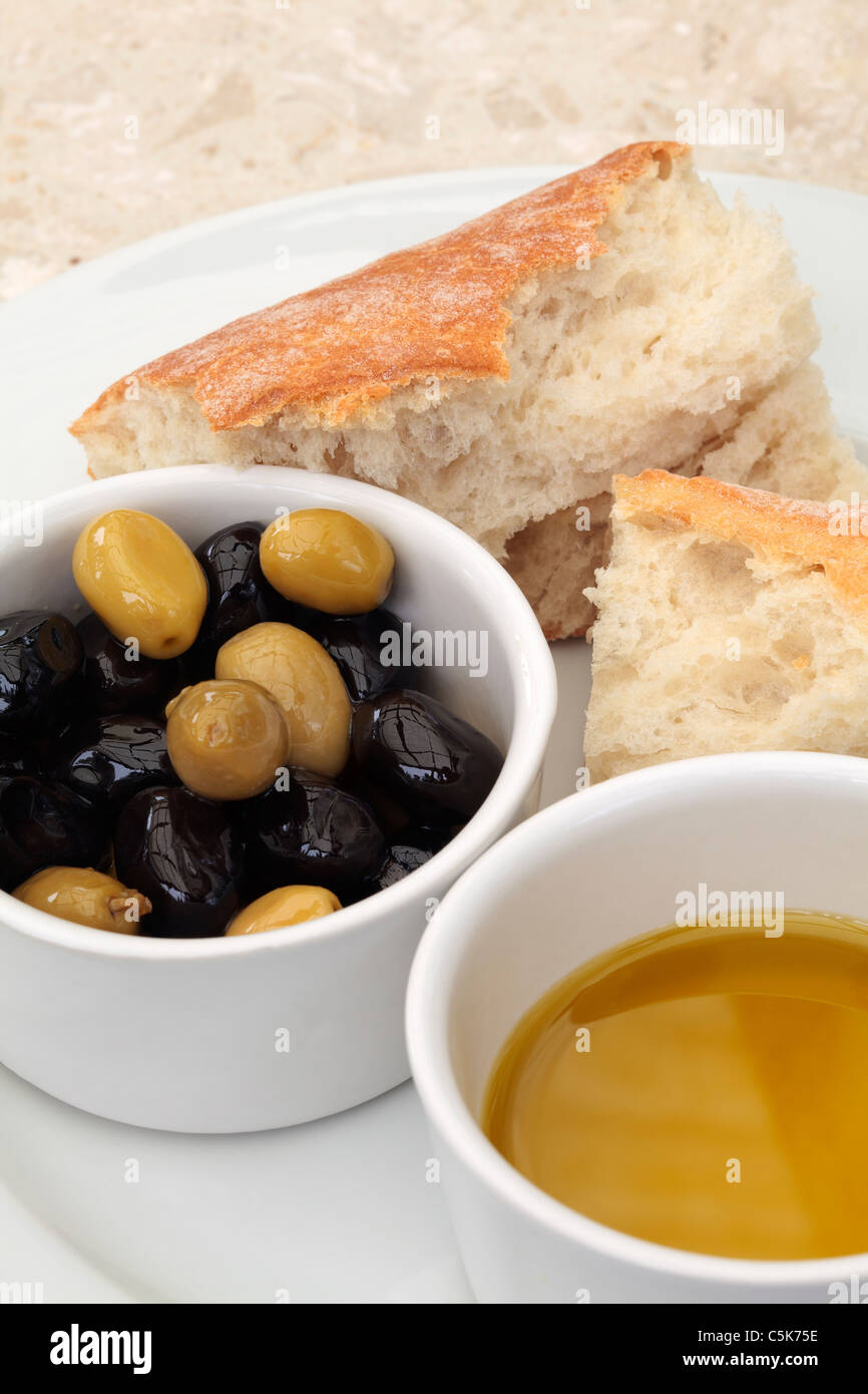 Olives, olive oil and bread - Stock Image