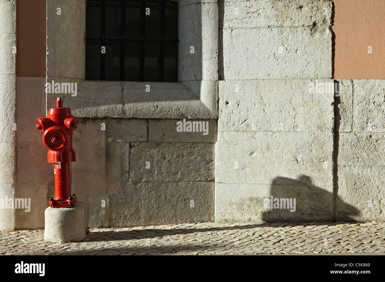 Red fire hydrant in a street of Lisbon, Portugal - Stock Image