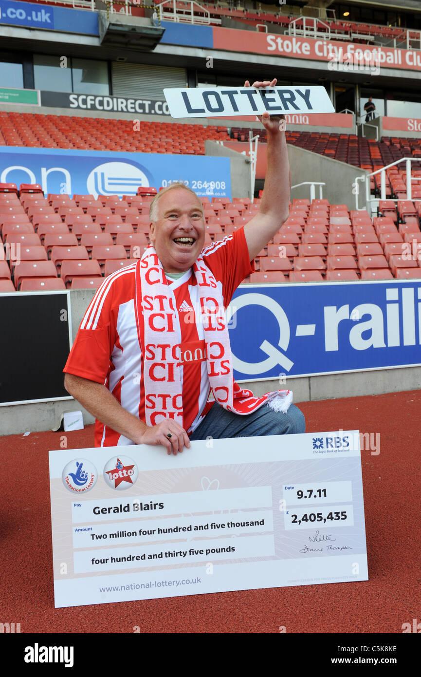 Stoke City football fan Gerald Blairs celebrates his £2,405,435 Lottery win - Stock Image