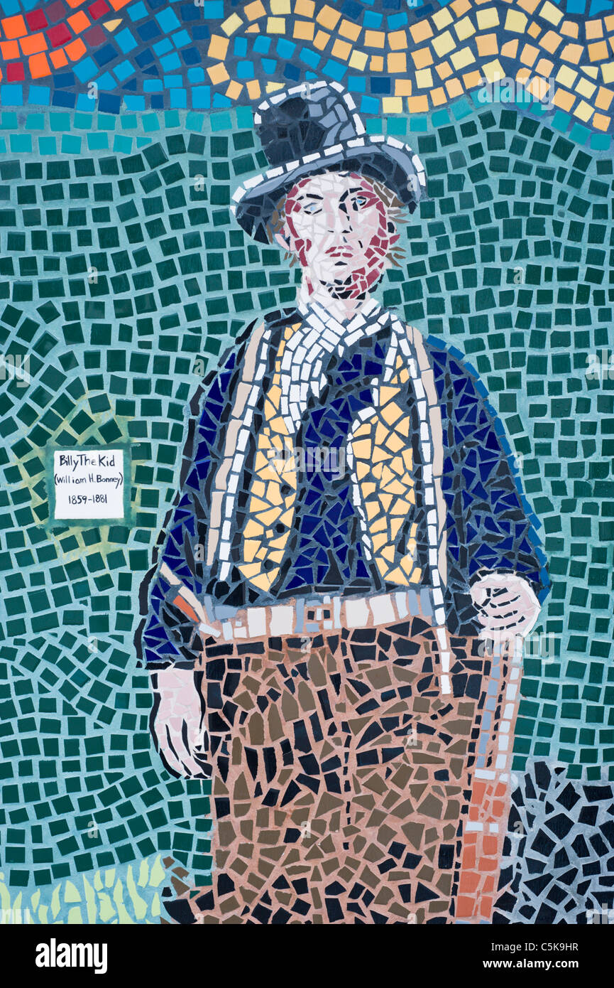 Mosaic artwork interprets the image of Billy the Kid on the wall of the visitors center in Ruidoso Downs, New Mexico. - Stock Image