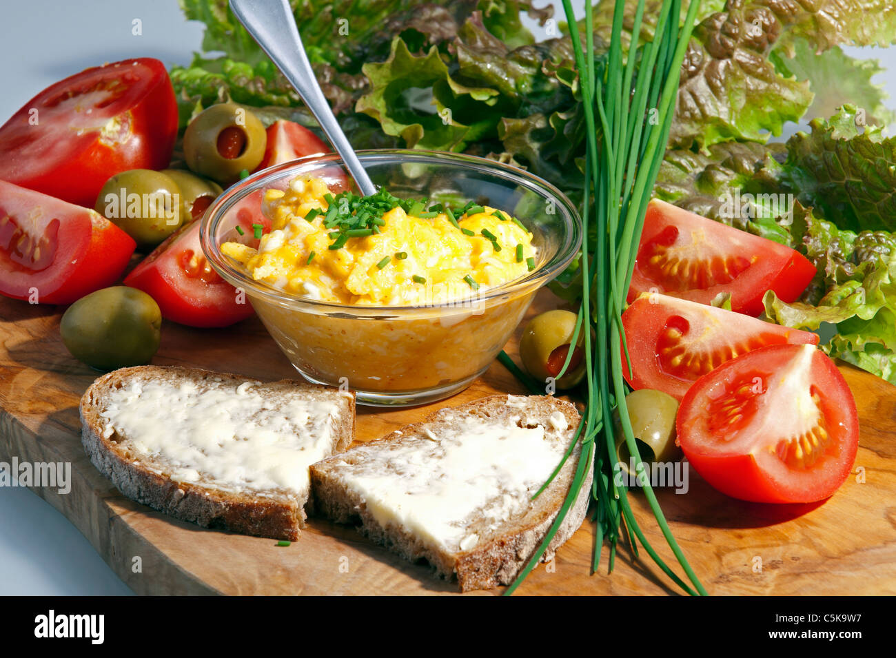 Breakfast plate with eggs and tomatoes - Stock Image