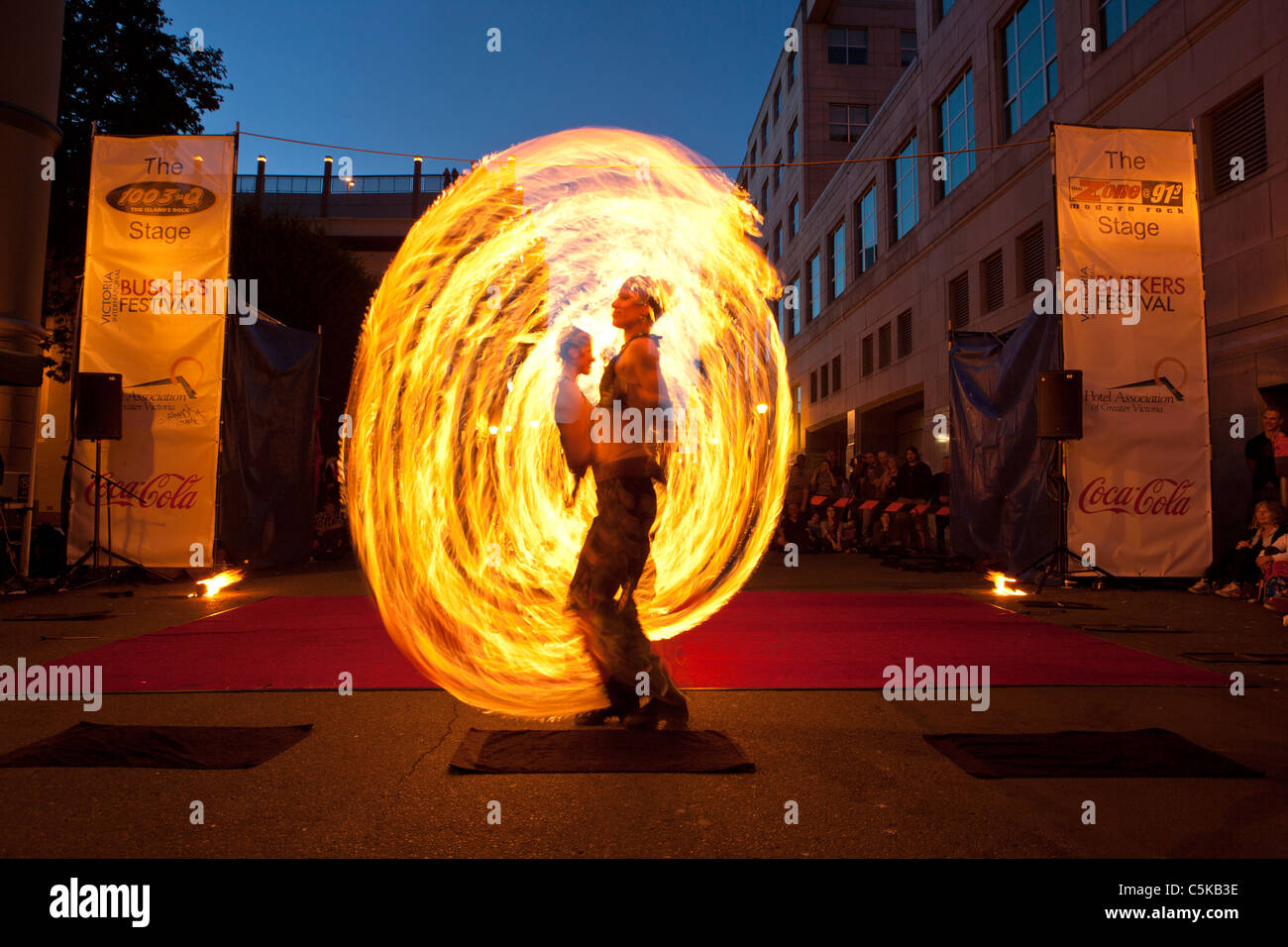 Flame Oz fire dancers entertaining at Victoria International Street Busker festival-Victoria, British Columbia, - Stock Image