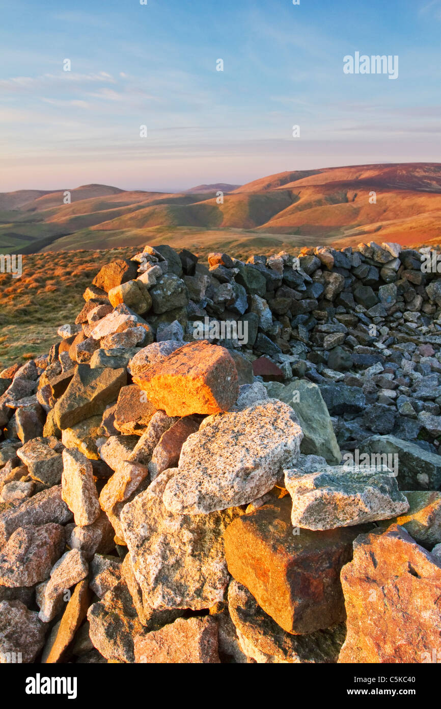 Russell's Cairn at the summit of Windy Gyle on the Border Ridge and Pennine Way in the Northumbrian Cheviot - Stock Image