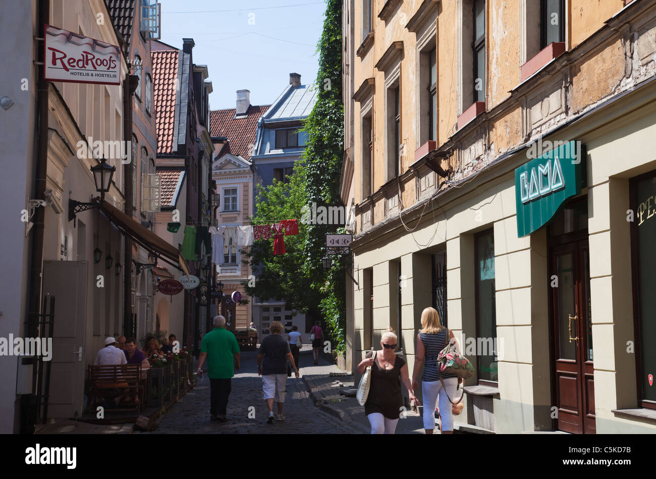 Riga Latvia old town tourists at cafe´and historic old buildings - Stock Image