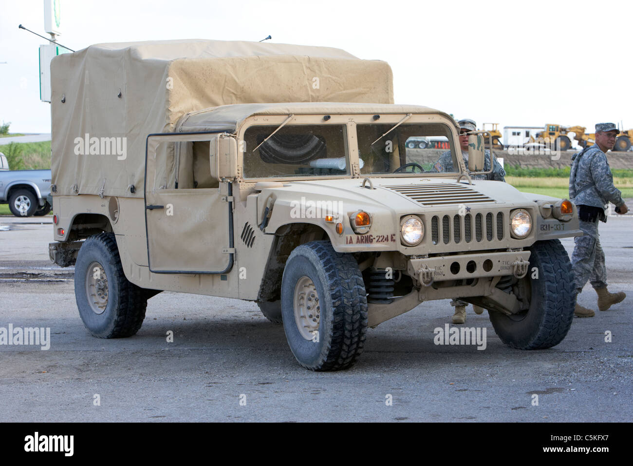 Iowa army national guard humvee and soldiers united states military in front of levees at the missouri river - Stock Image