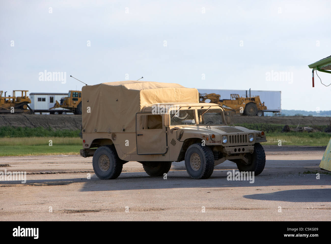 Iowa army national guard humvee united states military in front of levees at the missouri river - Stock Image