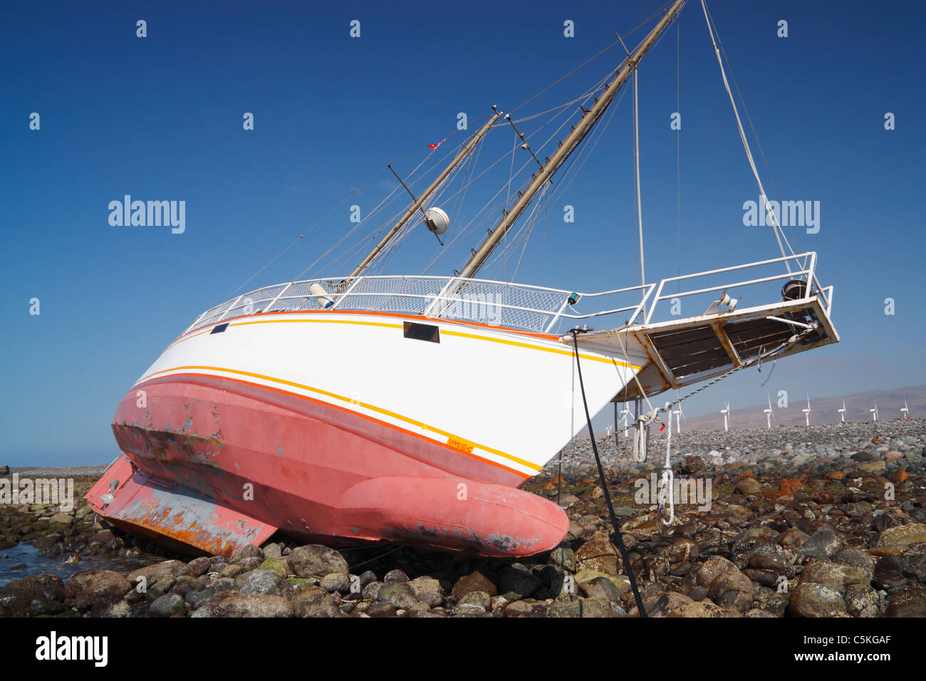 Steel hulled yacht aground on rocks on east coast of Gran Canaria - Stock Image