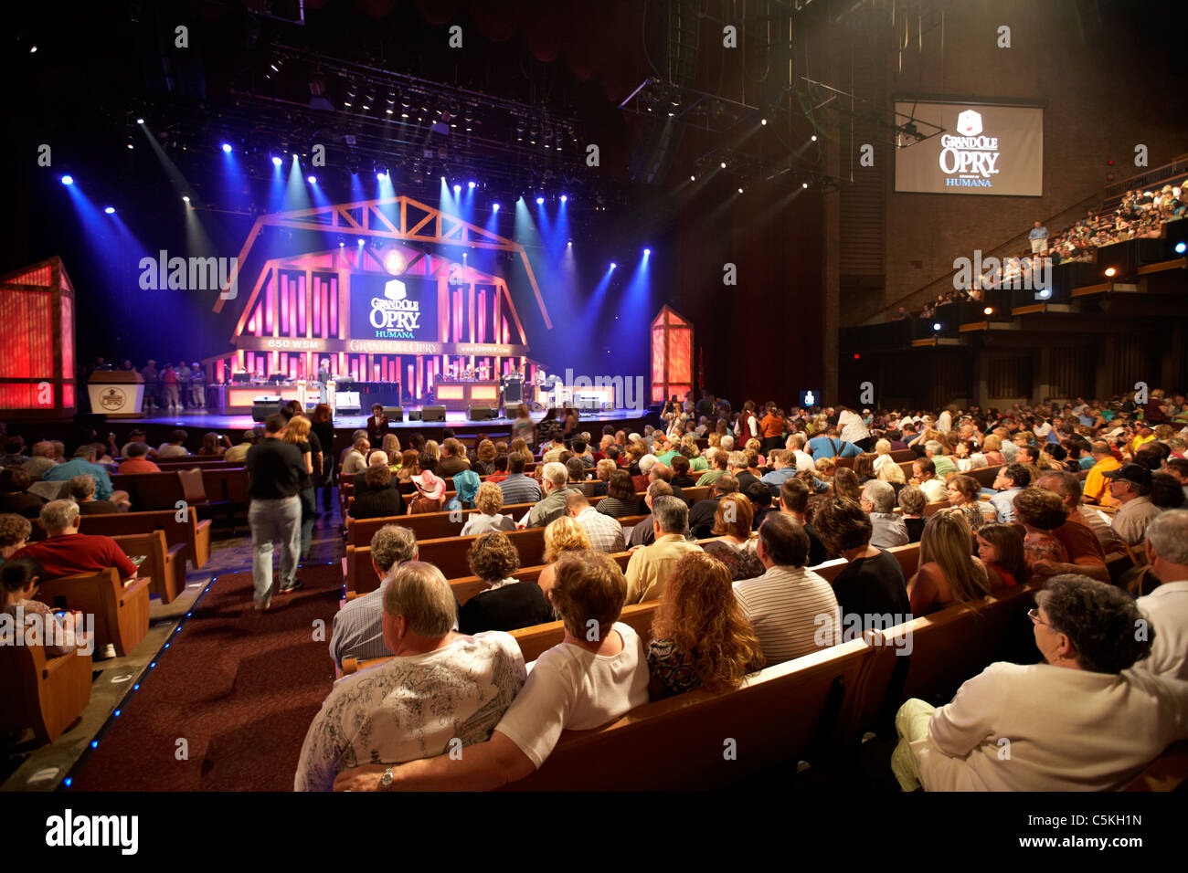 crowd seated inside the grand ole opry nashville tennessee stock