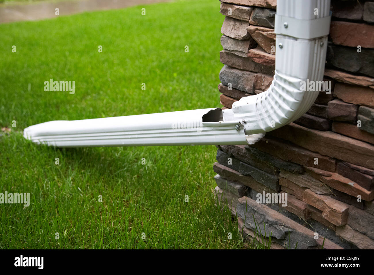 drain spout extension to keep rain away from building and basements in Canada - Stock Image