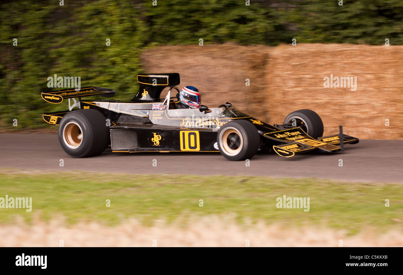 John Player Lotus 77 Formula One race car from 1977 performing at Goodwood Festival of Speed 2011 in the famous - Stock Image