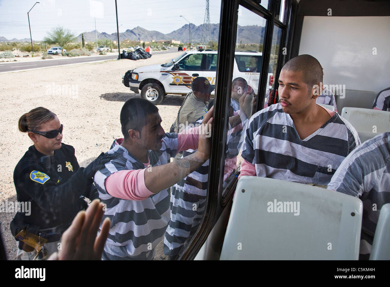 A Guard Searches Inmates For Contraband Near Phoenix Arizona Stock