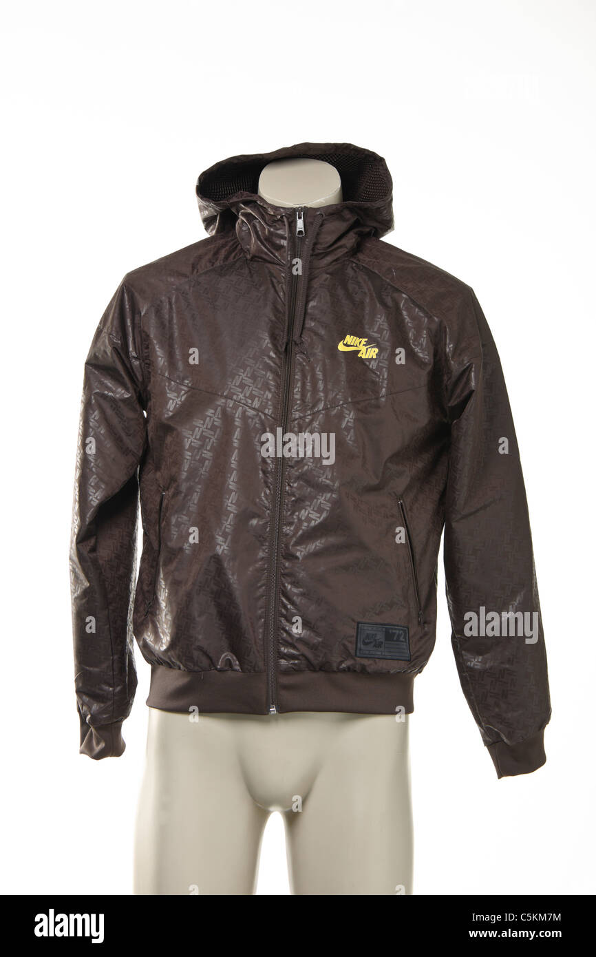 cb54d3363433 Mens Nike Air Windrunner sportswear nylon windcheater jacket in brown with  yellow logo and all over print detail.