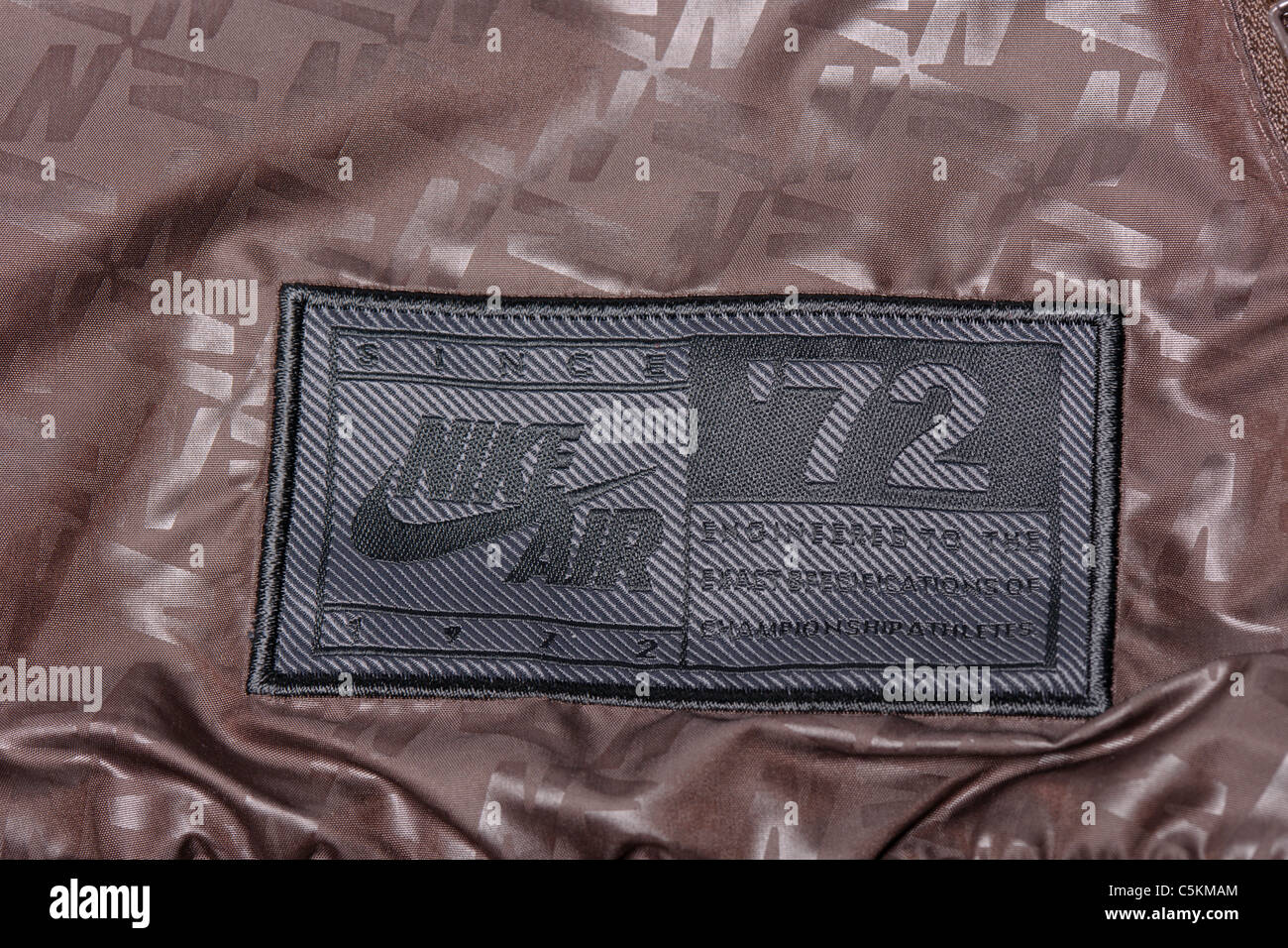 Mens Nike Air Windrunner sportswear nylon windcheater jacket in brown with and all over print detail. 1972 badge - Stock Image