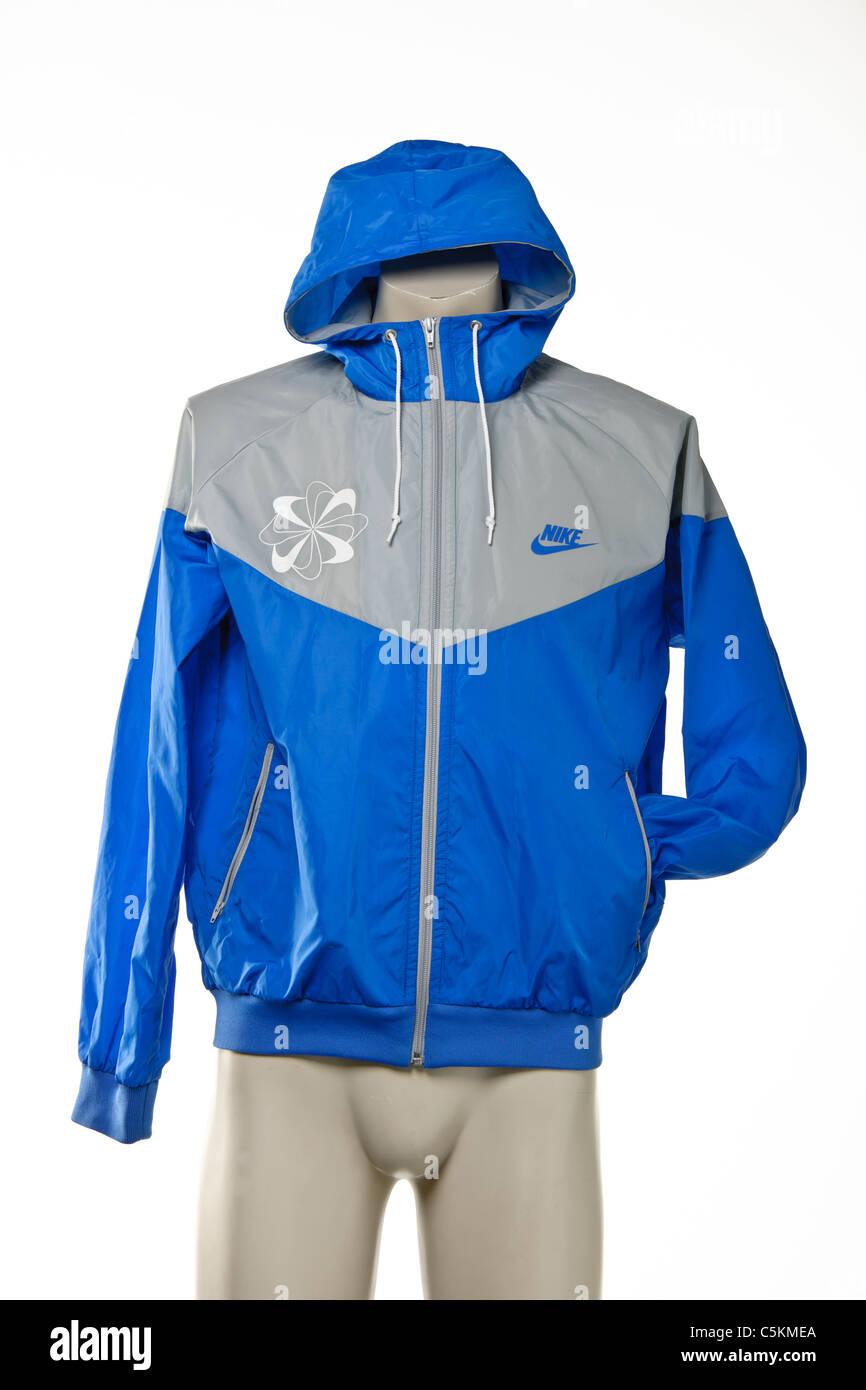 369568f30d Men s Nike Windrunner jacket in blue grey with Pinwheel logo and Nike  Swoosh logo.