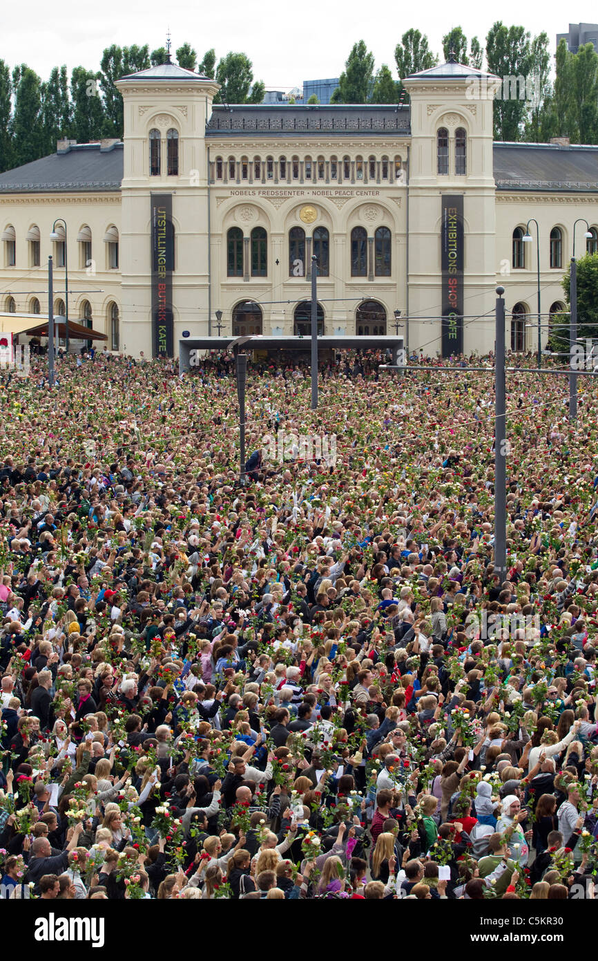 Thousands of Norwegian's gather at Nobel Peace Center to attend a rose flower vigil for victims of attacks.Photo:Jeff - Stock Image