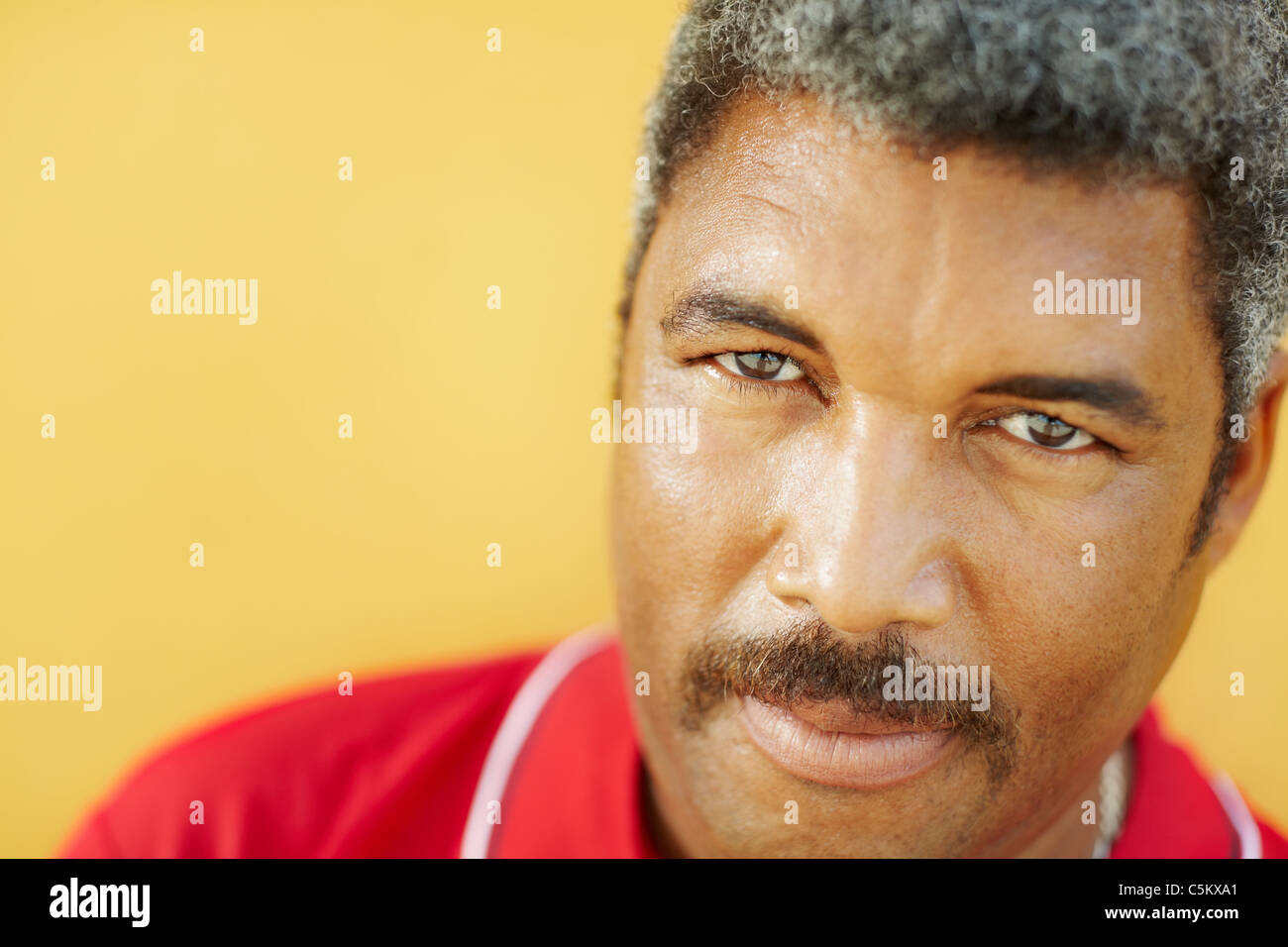 50 years old latin american man looking at camera with intense stare. Head and shoulders, copy space - Stock Image