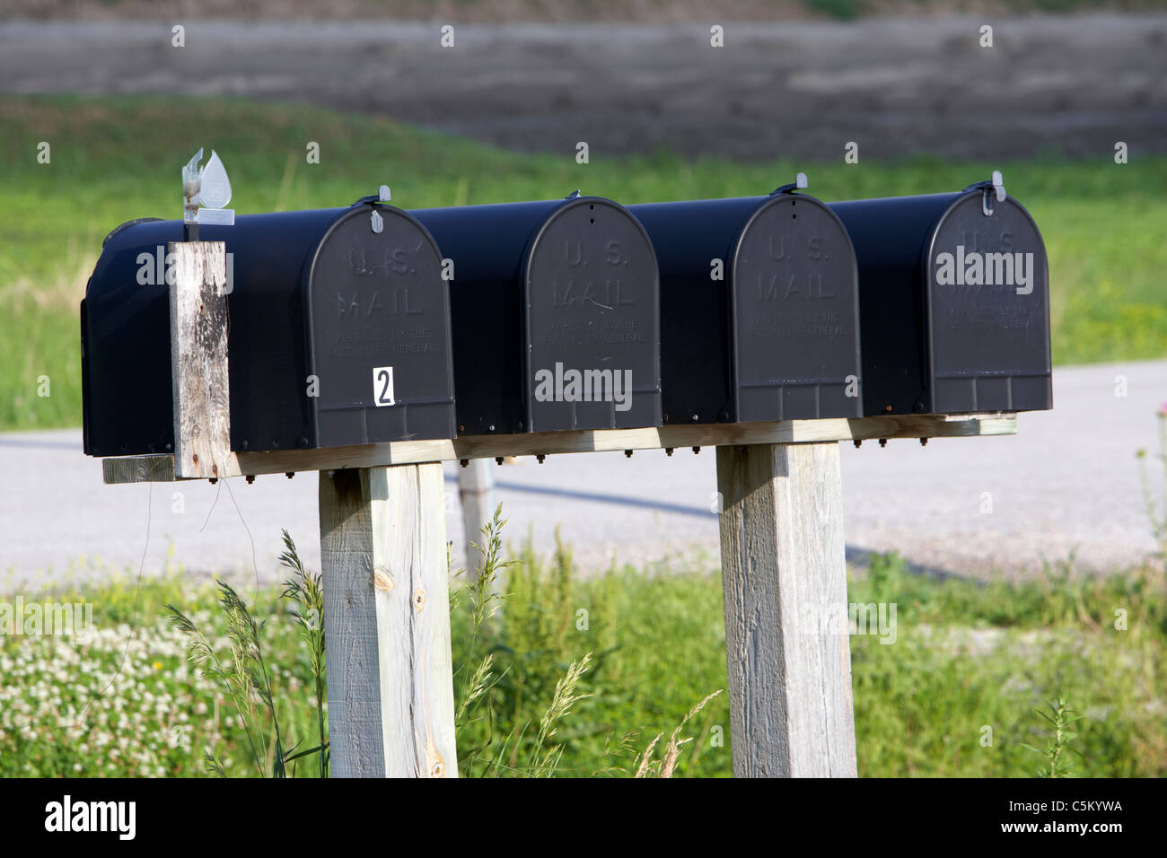 row of black us mail mailboxes in iowa united states of america - Stock Image