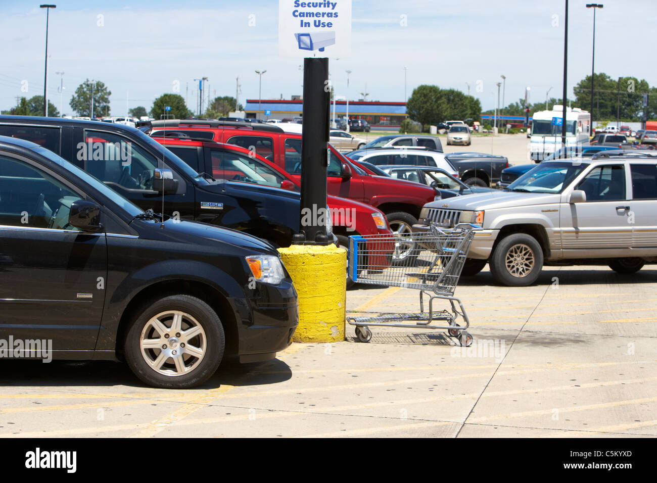 cars trucks suvs parked in car parking lot of supermarket in the usa - Stock Image